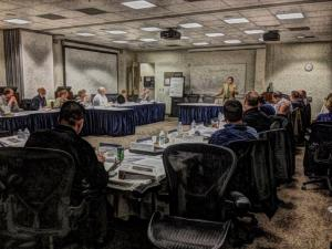 Rafe running a workshop of first responders at the Naval Postgraduate School.             Photo art by Angela English